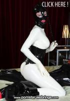 German Full Rubber Doll Latex Lara dominates on some Slave